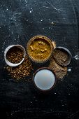 Close Up Of Ayruevdic Face Pack Of Mung Dal With Sandal Wood Or Chandan With Milk And Oats On Wooden poster