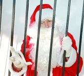santa claus is behind bars in jail and needs your help to either be bailed out or escape before dece