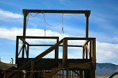 a gallows in a real ghost town in nevada usa with two nooses bringing to light the reality of Swift