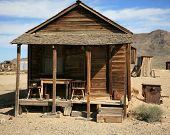 an old gold miners shack in a real ghost town from the 1800's in the wild west of california or neva