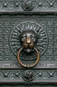 image of koln  - Bronze knocker in the shape of a lion head from the gate of the Cologne Cathedral - JPG