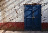 Blue door of a traditional Egyptian house in the village of Dra Abul Naga near Luxor, Egypt