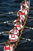 Female rowing team rowing ahead during a boat-race on the River Vltava in Prague, Czech Republic