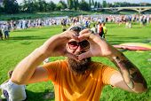 Man Bearded Hipster In Front Of Crowd People Show Heart Gesture Riverside Background. I Love Summer  poster