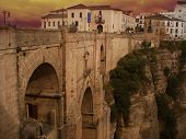 Ancient Bridge in Spanish town Ronda at sunset
