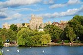 Panorama of the mighty Windsor castle, the home of the Queen, with the river Thames and boat trips d