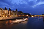 Palais de Justice standing on the banks of river Seine on the island Il de la Cite, Paris - France a