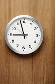 The aluminum wall clock is almost nine