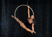 A Young Flexible Girl Performs The Splits In The Aerial Ring. Aqua Studio Shooting Performances On A poster