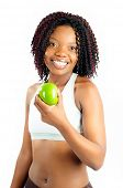 Beautiful Happy African American Woman Dressed For Fitness At The Gym Holding A Green Apple
