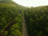 Aerial Drone View Of Foggy Highway / Road In The Adirondack Mountains Of Upstate New York. Morning C poster