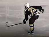 Hockey Player Skating Down The Ice
