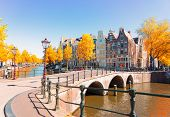 Houses Of Amsterdam Netherlands Over Canal Ring Landmark In Old European City, Amsterdam Fall Scener poster