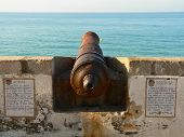 stock photo of pirate ship  - Old cannon overlooking Mediterannean Sea in Sitges  - JPG