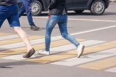 People Crossing The Pedestrian Crossing On Sunny Summer Day poster