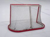 Empty hockey net on ice