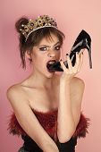 Glamour Style Of Woman Eating Fashionable Shoe. Glamour Woman In Luxury Crown With Stylish Makeup poster