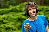 happy teenage boy in headphones