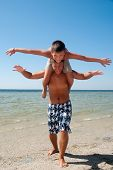 image of summer fun  - Joyful brothers having fun at the beach - JPG
