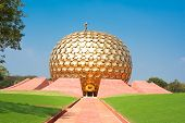 Auroville meditation hall. Auroville is a  human unity where people could live in peace and progress