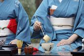 Japanese Woman In Traditional Kimono Preparing Japanese Green Tea Ceremony At Garden poster