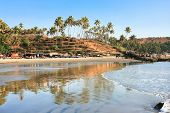 Panoramic view of beautiful tropical beach little Vagator, Goa, India