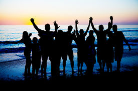 pic of beach party  - Silhouettes of young happy people enjoing sunset at the Florida beach - JPG
