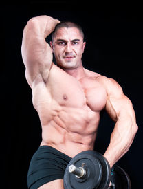 pic of weight-lifting  - Man  with a bar weights in hands training - JPG