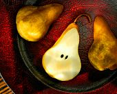 Pear Stilllife On A Red Leather Plate