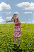 picture of hulahoop  - Beautiful little girl with a hula hoop - JPG