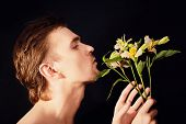 Oung Men Sniffing Bouquet Of Flowers