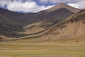 picture of manali-leh road  - Moray Plains 4400m up in the mountains of Ladakh on the Manali to Leh highway. Large flat area of short grass bounded by mountains.