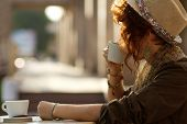Stylish Lady Drinking Coffee Outdoors