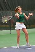 Female Tennis Player Hits Forehand During Match