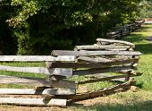 picture of split rail fence  - Traditional split rail fence by side of woods or forest - JPG
