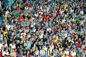 Odessa, Ukraine - August 20, 2012: People Watch The Football Game Of Ukraine Championship Between Mi