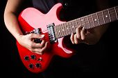 picture of potentiometer  - Closeup view of playing electric red guitar - JPG