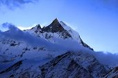 Trekking In Nepal Himalaya: Fishtail Peak In The Dawn poster