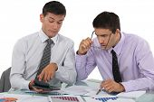 Businessmen scrutinizing results