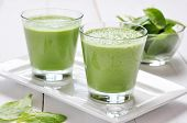stock photo of smoothies  - Spinach smoothies in glass on a wooden background