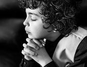 Young Latin Boy Praying