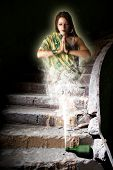picture of genie  - fabulous girl genie out of the bottle in an abandoned dark room - JPG