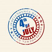 Blue and red rubber stamp for 4th of July, American Independence Day on brown background.