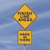 picture of perseverance  - A road sign announcing the finish line coming up - JPG