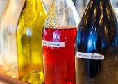 stock photo of vinegar  - Bottles of vinegars and oils at a salad bar - JPG