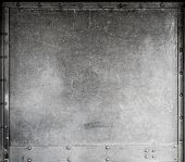foto of titanium  - Scratched metallic background with rivets - JPG
