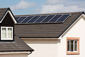 Photovoltaic Solar Panels On Tiled Roof