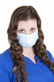 Nurse In Blue Scrubs With Mask