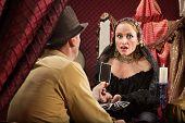 Man Shows Woman A Tarot Card