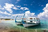 Two Tourist Boats In Quay Of The Island In Indian Sea